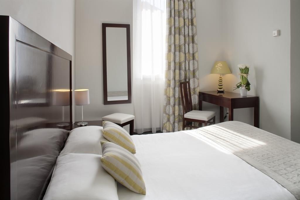 Pokoj hotelu Relais Acropolis.