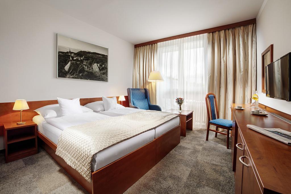 Interiér pokoje v 4* hotelu Clarion ve Špindlerově mlýně